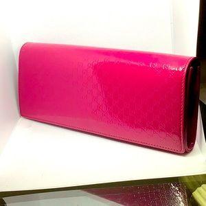 Hot pink Gucci clutch patent leather